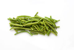 Green beans. A pile of green beans in a white background stock photo