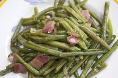 Green beans with bacon. Fried green beans with bacon and pecorino royalty free stock photo