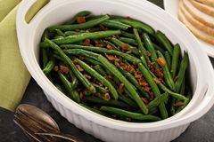 Green beans with bacon for Thanksgiving or Christmas dinner. Green beans with bacon, side dish for Thanksgiving or Christmas dinner stock image