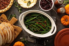 Green beans with bacon for Thanksgiving or Christmas dinner. Green beans with bacon, side dish for Thanksgiving or Christmas dinner overhead shot stock photo