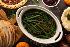 Green beans with bacon for Thanksgiving or Christmas dinner. Green beans with bacon, side dish for Thanksgiving or Christmas dinner overhead shot stock photography