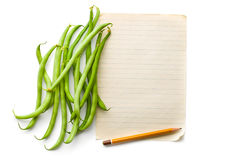 Green beans and blank sheet paper Stock Photos