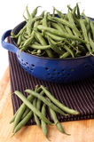 Green beans in a blue strainer Royalty Free Stock Photo