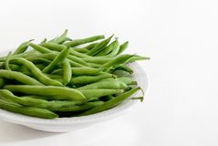 Green Beans in Bowl. Raw green beans in bowl with white background stock photo
