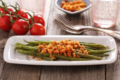 Green beans with breadcrumbs. On a plate Stock Photo