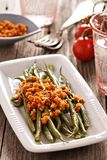 Green beans with breadcrumbs. Green beans with spicy breadcrumbs on a plate Stock Photography