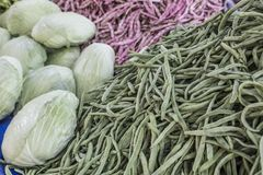 Green beans, cabbages and some vegetables as a background. In a grocery Royalty Free Stock Photo