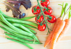 Green beans, Cherry tomatoes, baby Carrots and salad leaves Stock Image