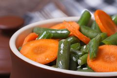 Green beans with chopped carrots and sesame seeds Stock Photography
