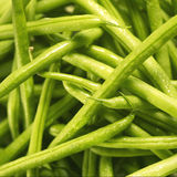 Green beans close up. Extreme close up of a large pile green beans Royalty Free Stock Photos
