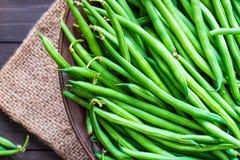 Green beans close up. Green beans close up on rustic wood background Stock Photos