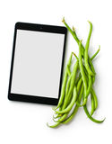 Green beans and computer tablet Royalty Free Stock Photo