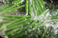 Green beans cooking in boiling water Royalty Free Stock Photo