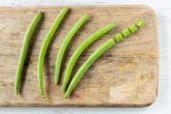 Green beans. Fresh raw green beans on a chopping board Stock Photography