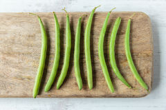 Green beans. Fresh raw green beans on a chopping board Royalty Free Stock Photography