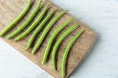 Green beans. Fresh raw green beans on a chopping board Stock Photo
