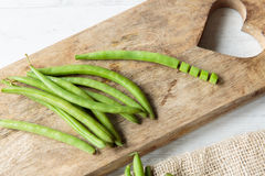 Green beans. Fresh raw green beans on a chopping board Stock Image