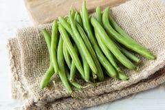 Green beans. Fresh raw green beans on jute cloth Stock Photography