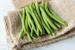 Green beans. Fresh raw green beans on jute cloth Royalty Free Stock Photos