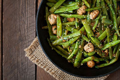 Green beans fried with chicken meatballs and garlic Stock Images