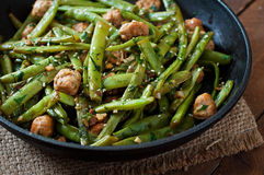Green beans fried with chicken meatballs and garlic Royalty Free Stock Images