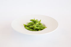 Green beans. Fried in a white plate Royalty Free Stock Photo