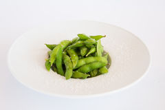 Green beans. Fried in a white plate Royalty Free Stock Photos