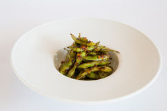 Green beans. Fried in a white plate Stock Photography