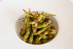 Green beans. Fried in a white plate Stock Photo