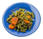 Green beans with garlicand carrots  on a plate isolated on white background.green beans with carrot top view. healthy  food. Green beans with garlicand carrots royalty free stock photos