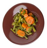 Green beans with garlicand carrots  on a plate isolated on white background.green beans with carrot top view. healthy  food. Green beans with garlicand carrots royalty free stock image