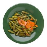 Green beans with garlicand carrots  on a plate isolated on white background.green beans with carrot top view. healthy  food. Green beans with garlicand carrots stock photo