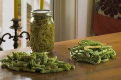 Green Beans. Half white runner green beans, snapped and canned Stock Image