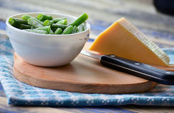 Green beans and hard cheese Stock Photography
