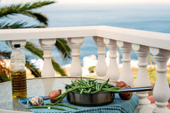 Green beans on a Mediterranean roof terrace Royalty Free Stock Image