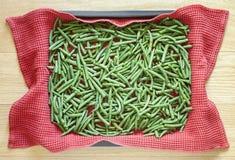 Green beans in metallic baking dish Royalty Free Stock Images