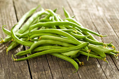 Green beans on old table Stock Images
