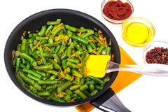 Green beans with onions and carrots. Delicious balanced nutrition concept. Studio Photo royalty free stock images