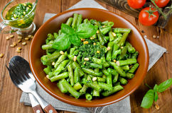 Green beans with pesto and pine nuts Royalty Free Stock Image