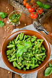 Green beans with pesto and pine nuts Royalty Free Stock Photography
