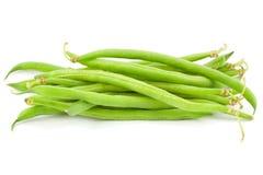 Green beans pile. Green bean pile over white Stock Photography