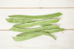 Green beans. Pile of green beans on wooden table Stock Photography