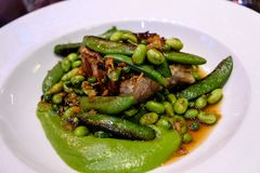 Green beans and pork served at bistrot in Paris stock photos