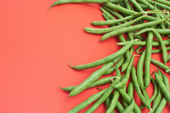 Green beans on red background with place Royalty Free Stock Image