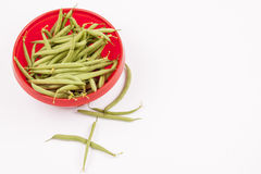 Green beans in red bowl Stock Image