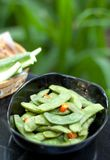 Green beans with red chilli in black bowl Stock Photo