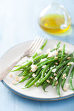 Green beans salad with goat cheese and pine nuts Stock Images