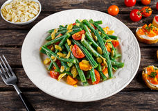 Green beans salad with Red, Yellow Tomatoes, bruschettas and flaked ...