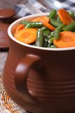 Green beans with sliced ??carrots in a pot Stock Photography