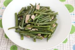 Green beans. Some cooked green beans with pork sausage stock images